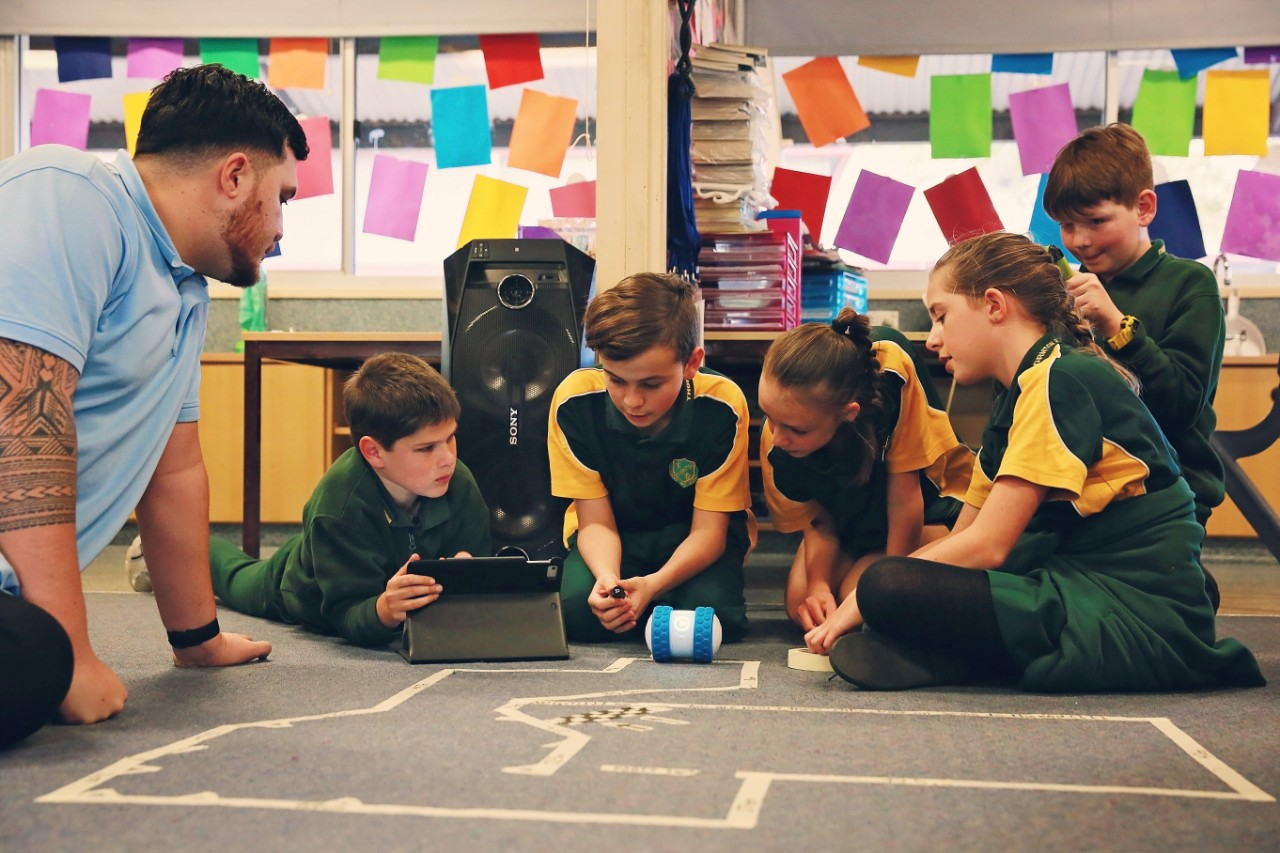 The students enjoy coding and robotics